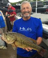 Mike holding a super nice 9.18 lb big bass (caught by Keith who had to leave early) to help them take 1st place on Lake Grapevine!!